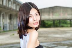 Asian woman at abandoned building Royalty Free Stock Photo