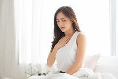 Asian Woman with Acid Reflux royalty free stock photos