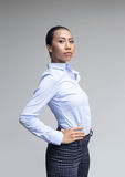 Asian woman action in business look Royalty Free Stock Photography