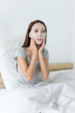 Asian woman adjust the facial mask. At home stock image