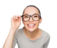Asian woman in adjusting eyeglasses Stock Photo