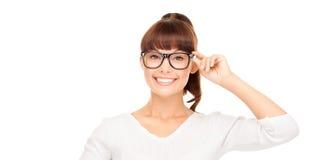 Asian woman adjusting eyeglasses. Happiness, health and vision concept - smiling asian woman adjusting eyeglasses stock photos