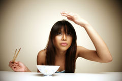 Asian woman adjusting her hair Royalty Free Stock Photography