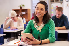 Asian woman in adult education class looking to camera. Asian women in adult education class looking to camera stock photo
