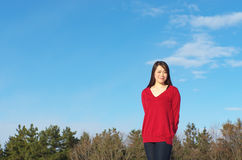 Asian woman agarinst clear sky Royalty Free Stock Image