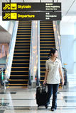 Asian woman at airport Stock Photos