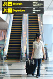 Asian woman at airport Stock Photo