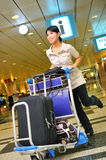 Asian woman at airport. Beautiful asian woman arriving at airport Royalty Free Stock Photo