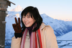 Asian Woman At the Alps royalty free stock photography