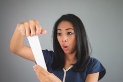 Asian woman amaze with the bill. Royalty Free Stock Images