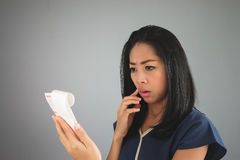 Asian woman amaze with the bill paper. Royalty Free Stock Photo