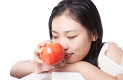 Asian woman and apple Royalty Free Stock Images