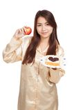 Asian woman with apple , bread and heart shape berry jam Stock Photo