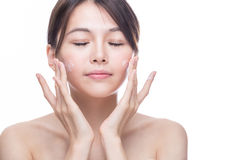 Asian woman applying cream Royalty Free Stock Image