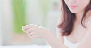 Asian woman applying hand cream royalty free stock images