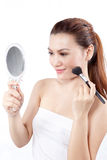 Asian woman applying make up stock photo