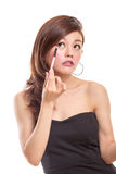 Asian woman applying make-up on eyes Royalty Free Stock Photography