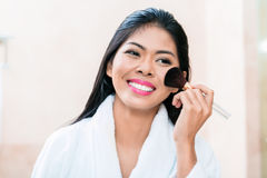 Asian woman in applying makeup Royalty Free Stock Photo