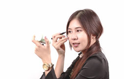 Asian woman applying makeup, using lipstick, for beauty concept Stock Image