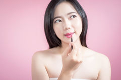 Free Asian Woman Applying Pink Lipstick On Her Lips, Beauty Face And Natural Makeup, White Background Isolated. Royalty Free Stock Photography - 94845677