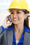 Asian Woman Architect. A pretty asian woman working as architect on a construction site Stock Photos