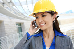 Asian Woman Architect. A pretty asian woman working as architect on a construction site Stock Photo