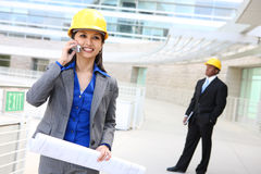 Asian Woman Architect. A pretty asian woman working as architect on a construction site Royalty Free Stock Image