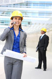 Asian Woman Architect. A pretty asian woman working as architect on a construction site Royalty Free Stock Images