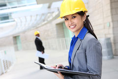 Asian Woman Architect. A pretty asian woman working as architect on a construction site Stock Images
