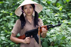 Asian woman armed Stock Photos