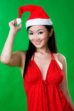 Asian woman as santarina. Wearing red dress in green background Stock Image