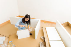 Asian woman assembling closet Stock Photos