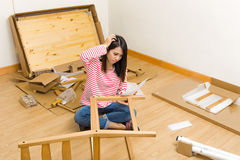 Asian Woman Assembling New Chair With Instruction Stock Photos