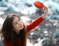 Asian woman in autumn day Royalty Free Stock Image