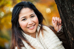 Asian woman in autumn portrait Stock Images
