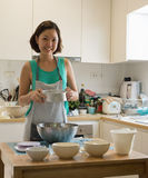 Asian woman baker preparing flour Royalty Free Stock Image