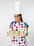 Asian woman baking cookies Stock Images