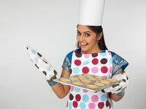 Asian woman baking cookies Royalty Free Stock Photos