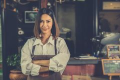 Asian woman barista successful small business owner standing in. Cafe. vintage color stock photos