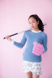Asian woman baseball on pink background. Royalty Free Stock Photo