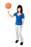Asian woman with basketball ball Royalty Free Stock Photography