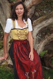 Asian woman in Bavarian traditional costume Royalty Free Stock Photography