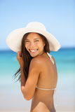 Asian woman beach portrait. Happy lifestyle photo of mixed race Asian Chinese / Caucasian young lady in bikini smiling pretty wearing beach hat on summer royalty free stock photos