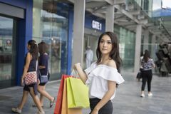 Asian women and Beautiful girl is holding shopping bags smiling Stock Photography