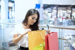 Asian women and Beautiful girl is holding shopping bags smiling royalty free stock photo