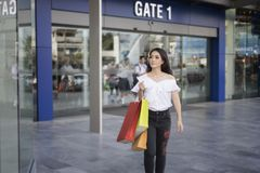 Asian women and Beautiful girl is holding shopping bags smiling Royalty Free Stock Images