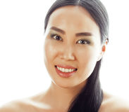 Asian woman beauty face closeup portrait. Beautiful attractive mixed race Chinese Asian / Caucasian female model with Stock Photography