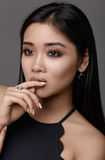 Asian woman beauty face closeup portrait. Model with perfect ski. Asian woman beauty face closeup portrait. Gray background Stock Image