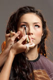 Asian woman in a beauty salon. Royalty Free Stock Photography