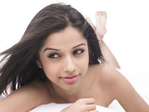 Asian woman in bed Stock Photography